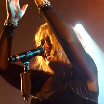 Kim singing 'A little respect' during a concert in Dossenheim sur Zinsel (France), May 12, 2012