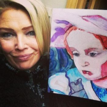 Kim Wilde with a painting auctioned for Joss Searchlight, 2013