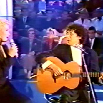 Laurent Voulzy and Kim singing 'Belle-ile-en-mer Marie-Galante' in the French TV programme 'Sacrée Soirée' on June 3, 1992.