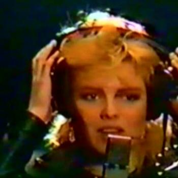Kim singing 'Is It Over' during a report on TVAM, ITV (UK), 17 November 1984