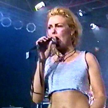 Kim performing 'Real Wild Child' live in Gross Gerau (Germany), 3 June 1994