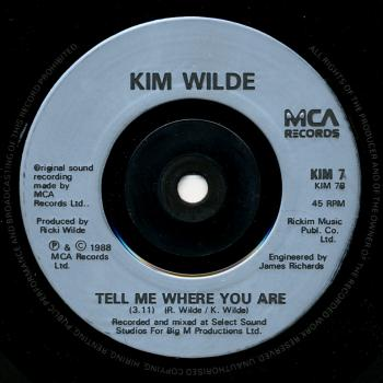 Label for 'Tell me where you are' on the B-side of 'Hey mister heartache' in the UK