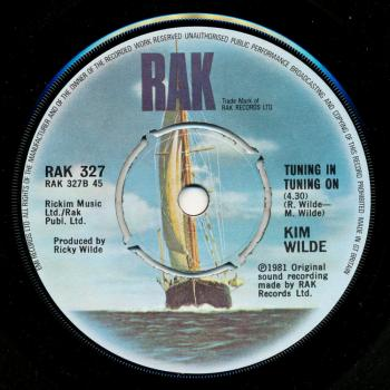 Label for 'Tuning in Tuning On' on the B-side of 'Kids in America' in the UK