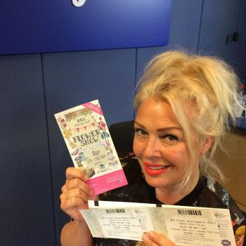 Kim with tickets for the RHS Hampton Court Flower Show in 2014