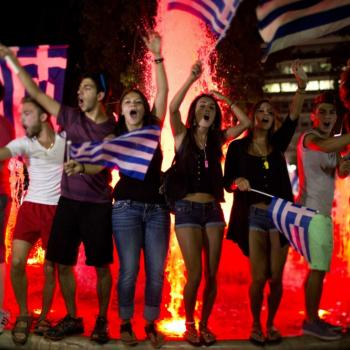 People celebrating the outcome of the Greek referendum on the streets in Athens, yesterday evening