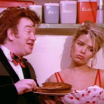 Mel Smith and Kim Wilde in the music video for 'Rockin' around the Christmas tree'